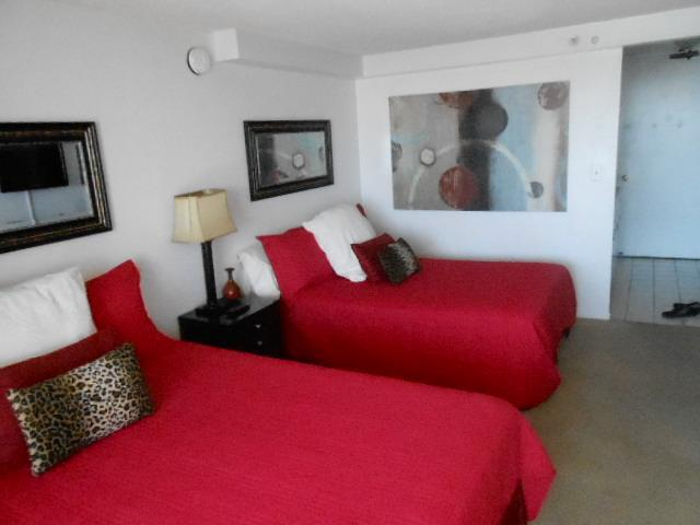 2 queen beds with bright comforters.  This is a studio.