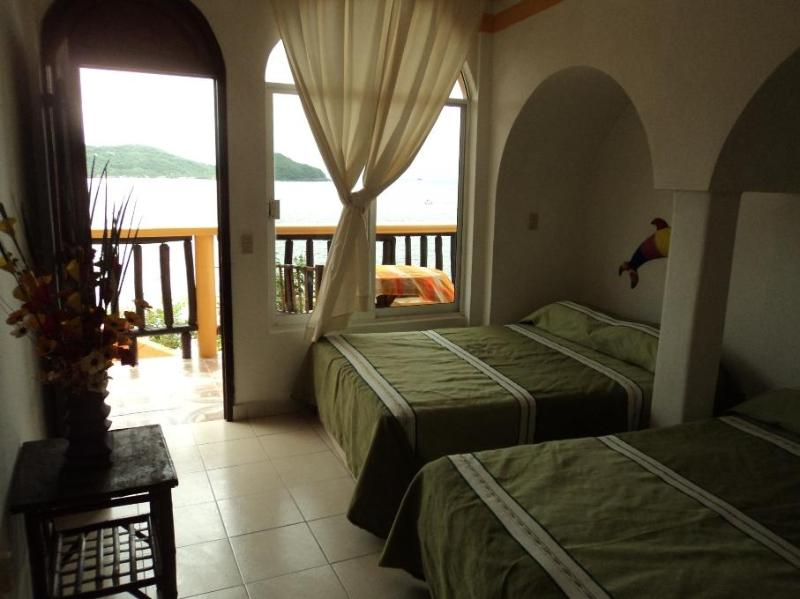 one room w/ two double beds and just balcony