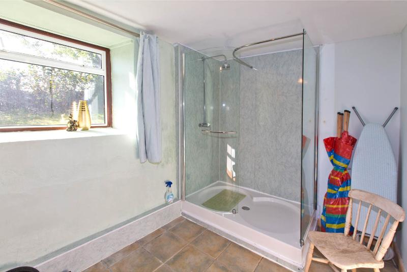 The downstairs shower room / utility room  just off the kitchen has a washing machine and  freezer