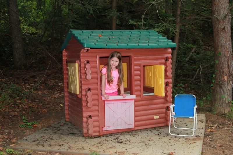 This log cabin playhouse is right next to Timber Hollow
