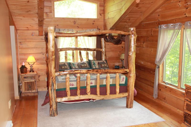 1 of 2 master suites w/ king log bed