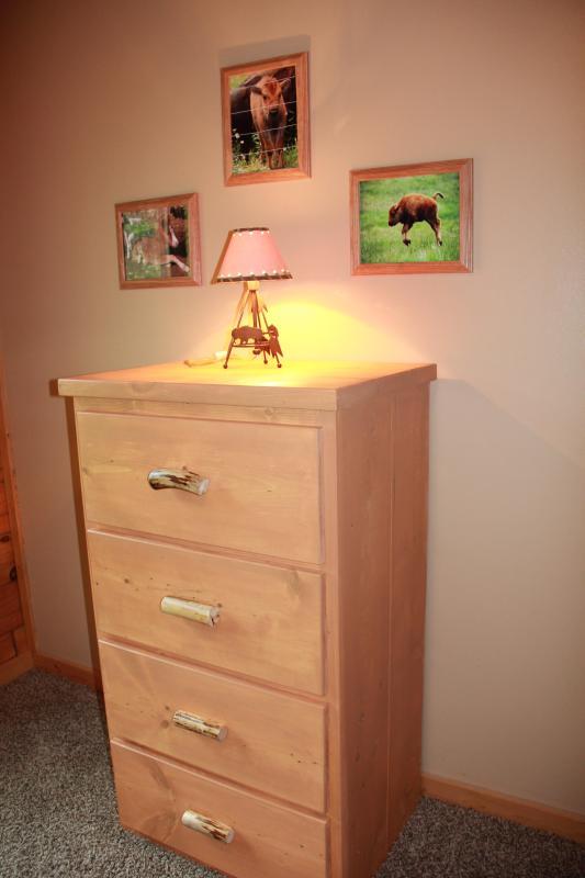 Each kids room has a dresser