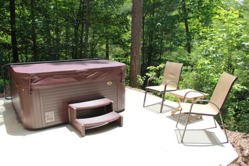Relax your worries away in our therapeutic hot tub under the stars
