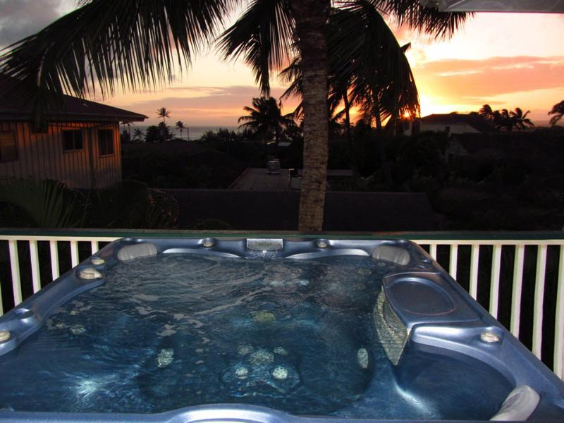 Imagine sitting in your private hot tub as you watch the sun setting on Poipu Beach