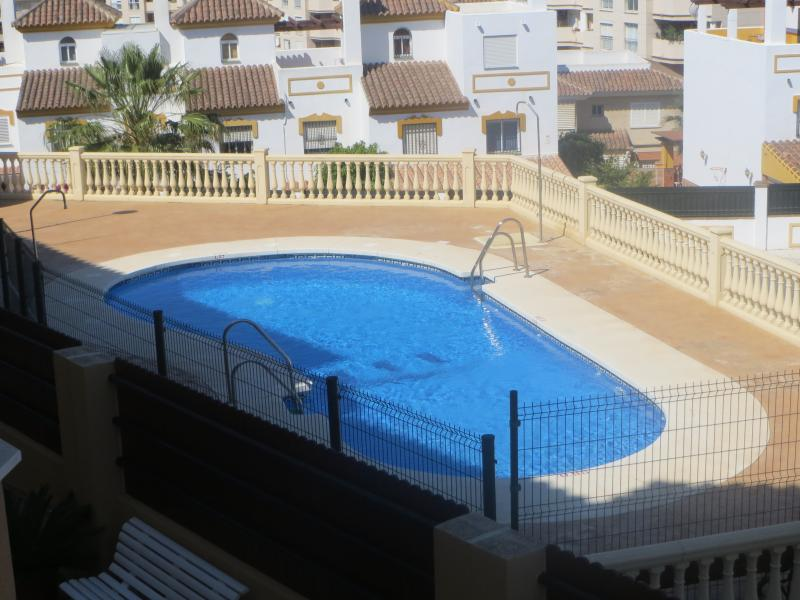 View of swimming pool from apartment
