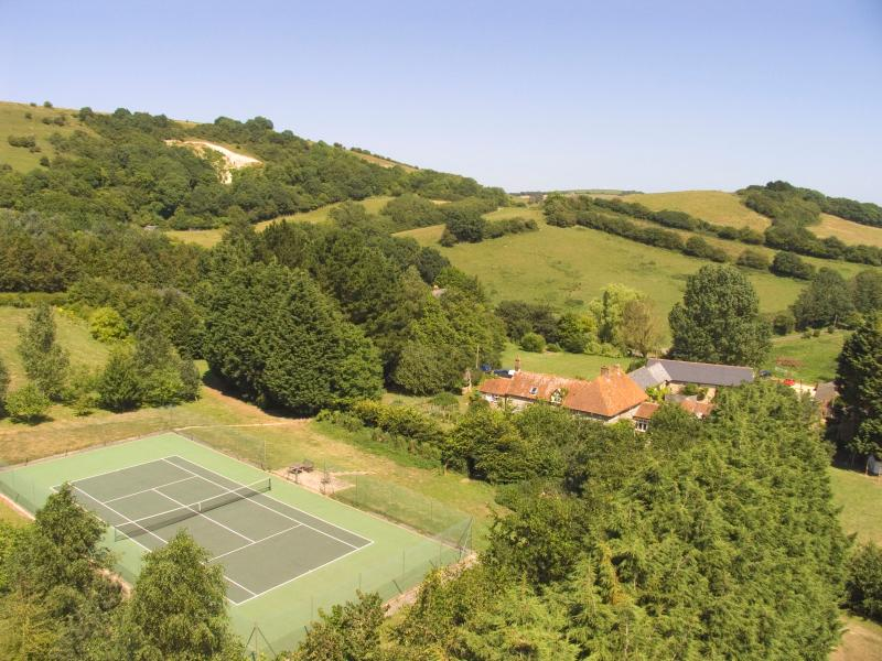 Private tennis court for guests use.