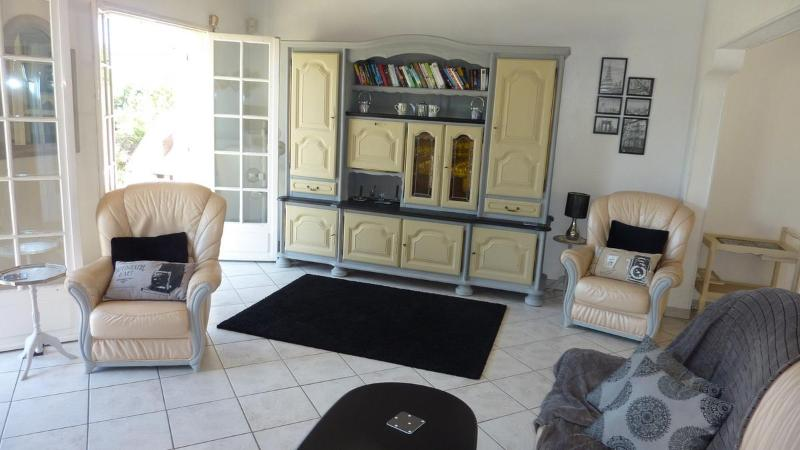 Lounge Room with doors leading to the Terrace