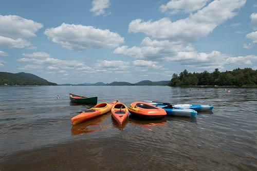 Our 4 kayaks, canoe and lake float on Lake Piseco - 10 minute kayak to this beautiful spot!