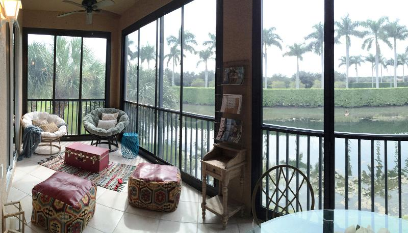 Private lanai overlooking beautiful pond surrounded by Royal palms