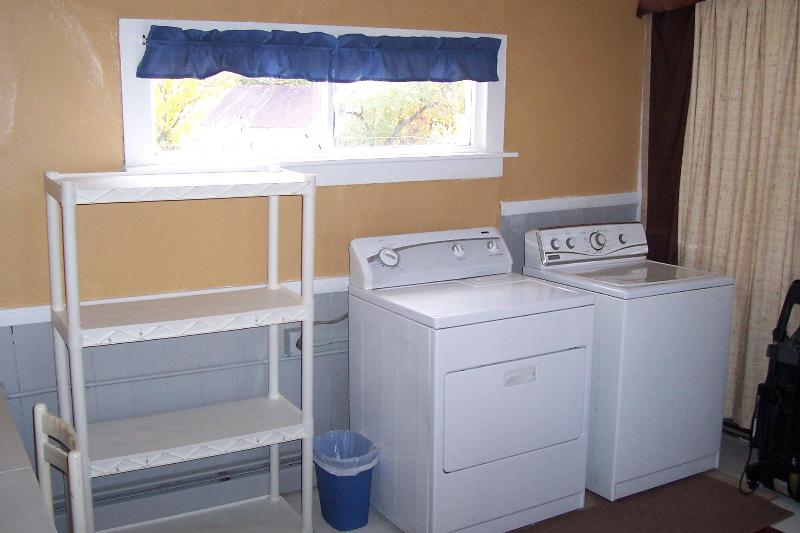 Large utility room with washer and dryer