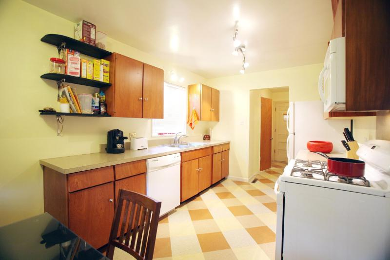 Kitchen has all the amenities plus and eat in table for six