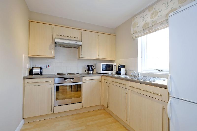 Well equipped kitchen with dishwasher and laundry facilities