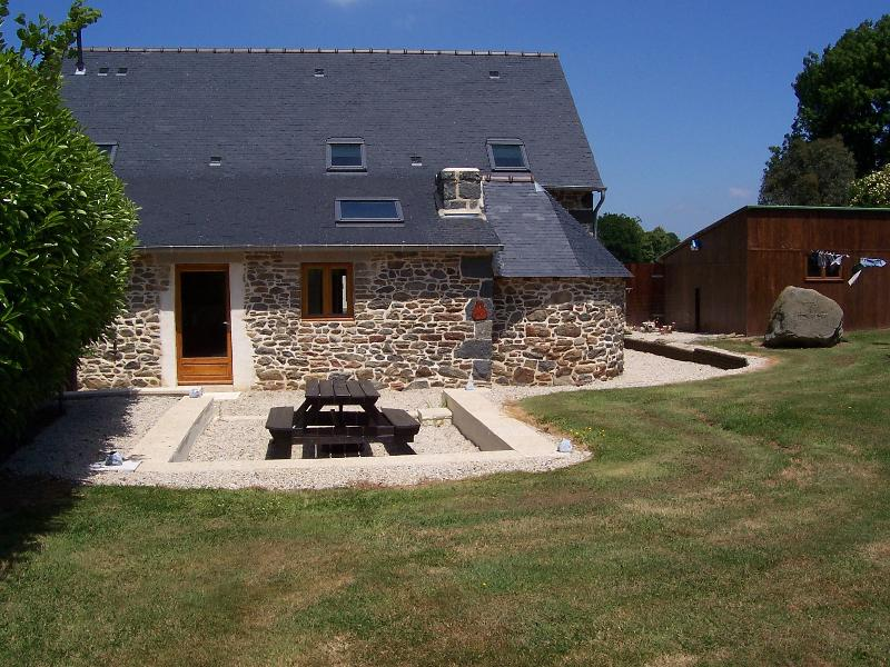 the back of La Chouette with its bread oven feature, patio and large secluded garden