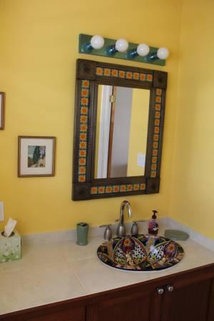 The master bathroom with Mexican sink and mirror, and large shower.