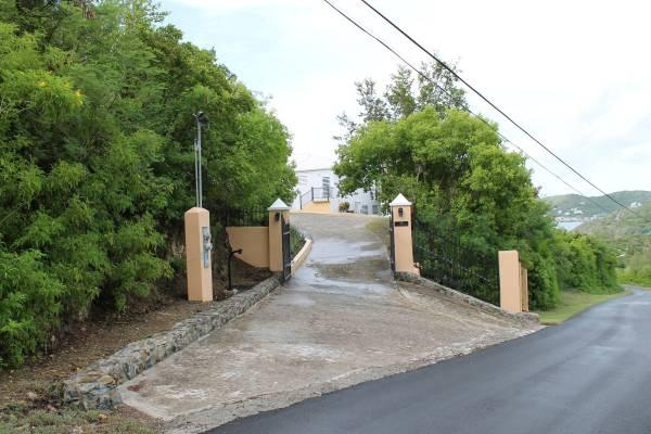 The gated driveway entrance.