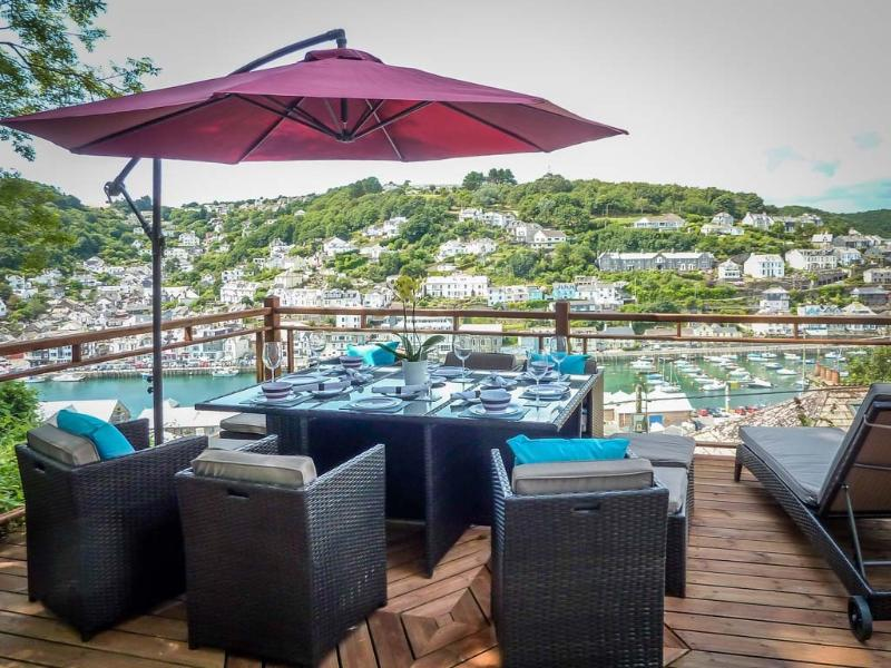upper decking area with panoramic harbour views. This is not a shared area and is for holiday guests