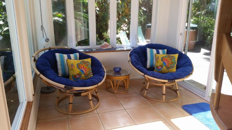Relax in our comfy papasan chairs with a glass of wine