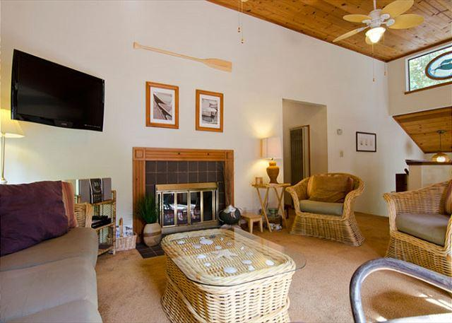 Spacious Living Area with High Ceilings, Plenty of Seating and a Fireplace