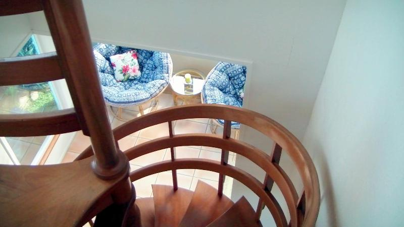 Climb our beautiful mahogany staircase to your hideaway bedroom