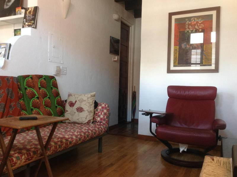 Small futon and two Stressless arm chairs