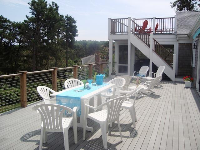 Awning for shade - gas grill and outdoor tables for dining - Waterfront North Chatham Cape Cod New England Vacation Rentals