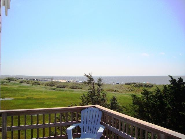 View from upper deck off of the dining area. Table and chairs provided with umbrella - 17 Uncle Venies South Harwich Cape Cod New England Vacation Rentals