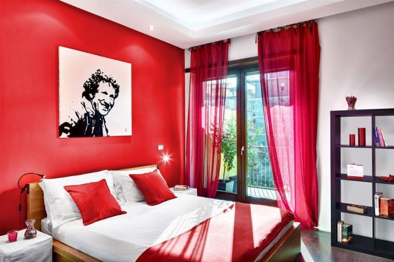 'Red' bedroom offers a comfortable double bed and ample space for hanging and storing clothes