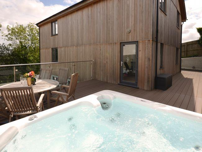 Fantastic enclosed decked area with hot tub and seating