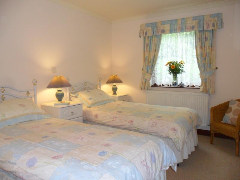 One of the two twin bedrooms which are of similar design & layout