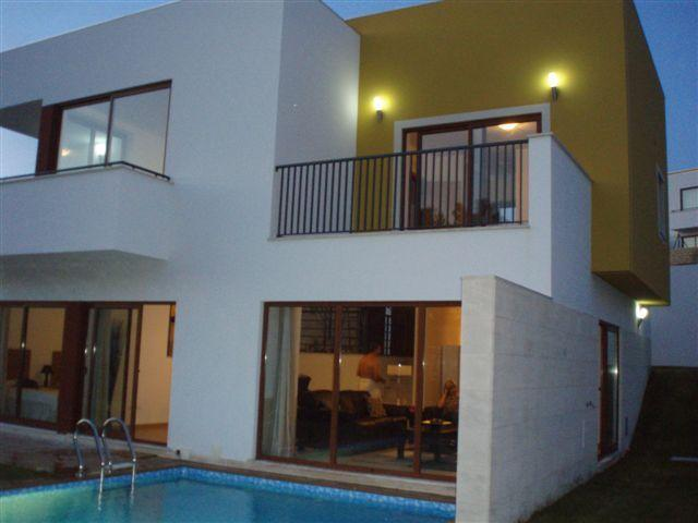 Villa with evening lighting for drinks and evening meal round the pool