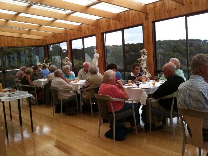 People enjoying while dining.