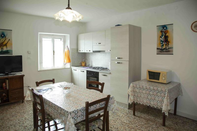 Kitchen furnished with 4 gas rings, electric oven, microwave, fridge with cell bilge pump