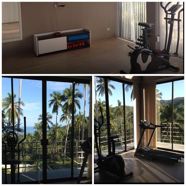 Fitness room with yoga, cross trainer, treadmill and hand weights