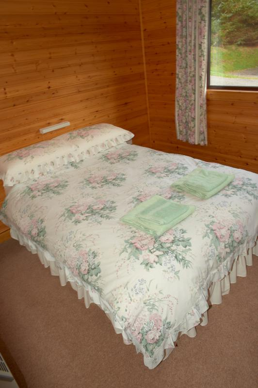 Double bedroom with wardrobe, dressing table, mirror and shaving point.