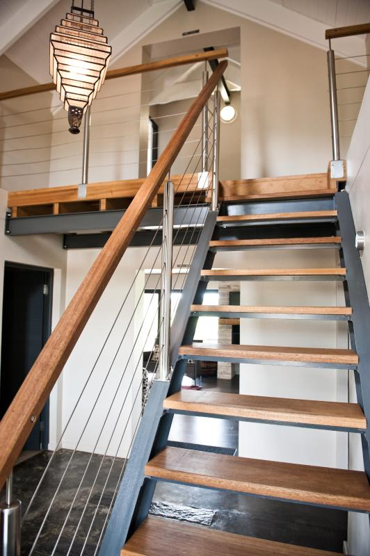 Staircase at entrance of house leading to rooms on second level