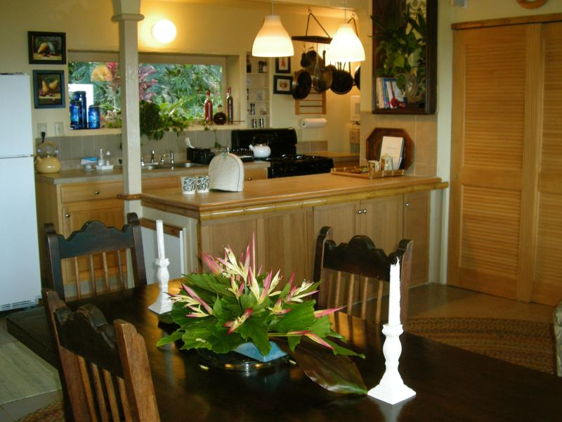 View into Fully Equipped Kitchen from Dining Area