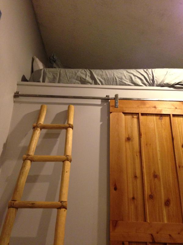 Kiva log ladder to sky bunk