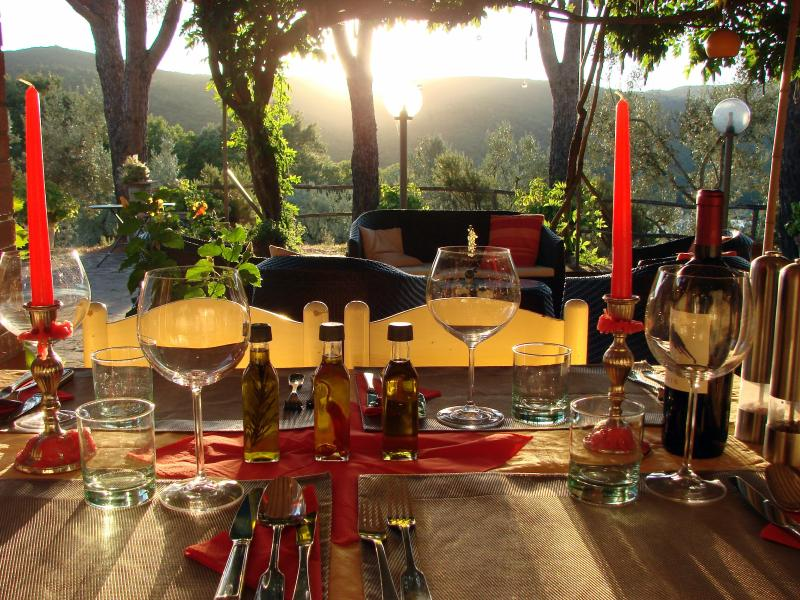 Your dining outdoor at the sunset with gorgeous hill and lake views
