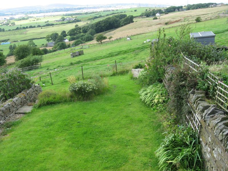 The view from the back windows, over the garden to the fields beyond