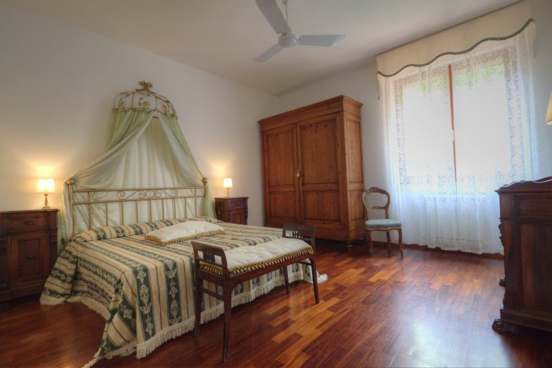 Gloria's bedroom with king size bed and private bathroom