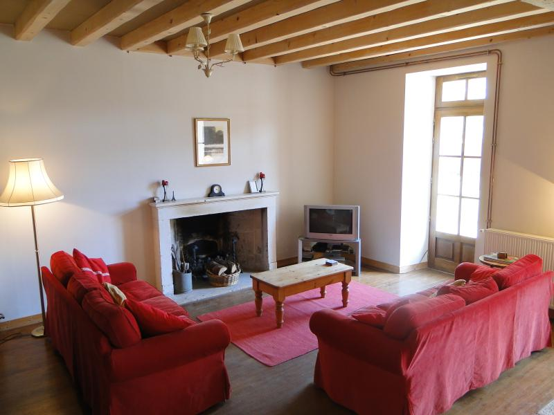 Lounge with open fireplace, UK free to air TV, DVD player, stereo