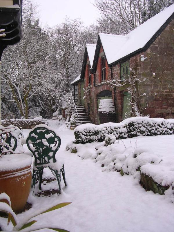 A wintry scene of the Coach House