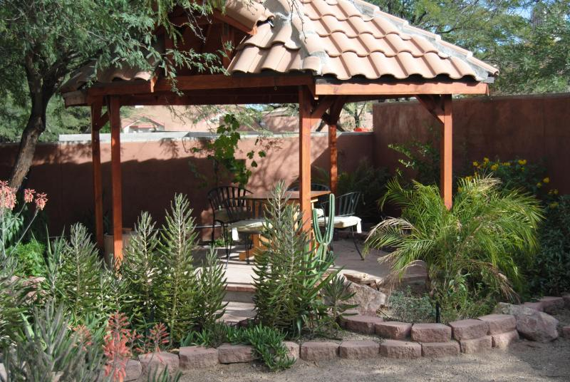 Cozy outdoor garden patio with ramada!