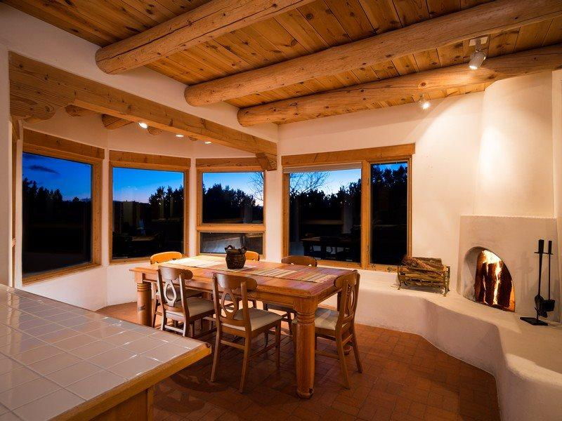 Dining area with working, kiva fireplace
