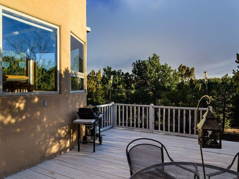 View from deck, outdoor seating, and BBQ grill