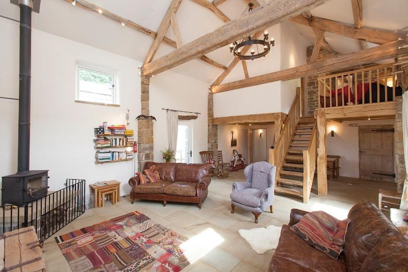 Spacious and airy 30 ft family sitting room.  Eco cosy underfloor heating throughout + log burner