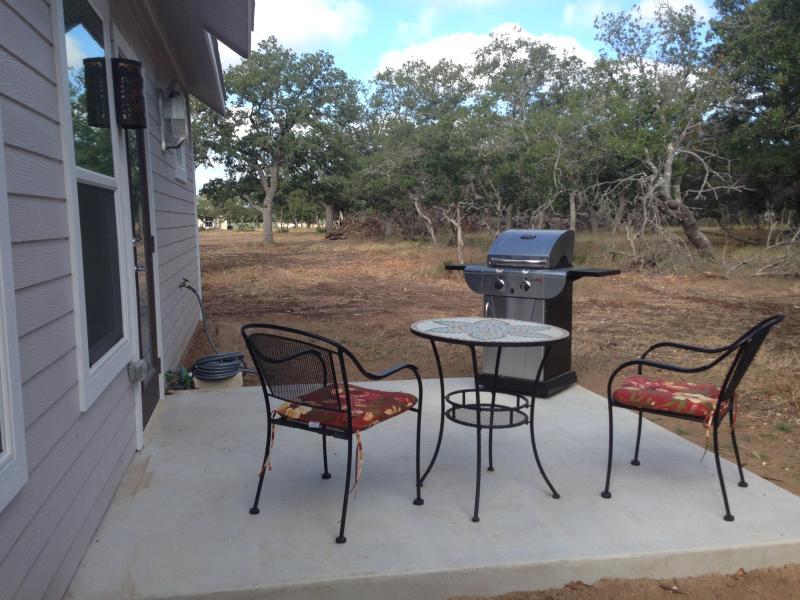 Sitzecke auf der Veranda mit Gas-grill