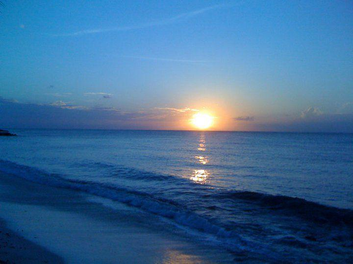 Golden sunset view from treasure beach's patio