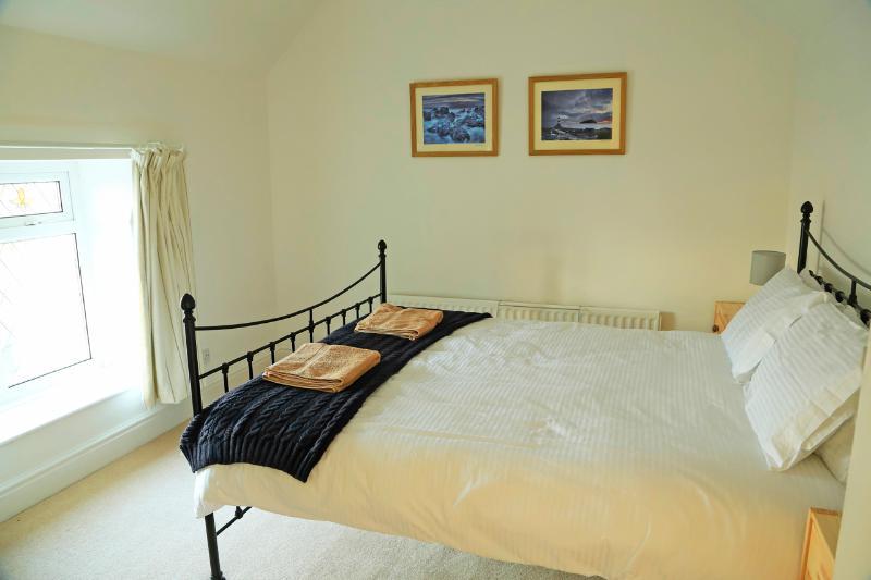 Bedroom 1 - Partial sea views