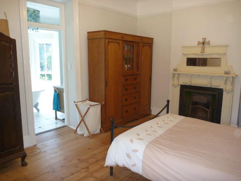 Main bedroom has a fireplace and en suite bathroom overlooking the garden